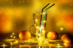 A mulled wine glass with magic lights in it stock image