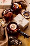 Mulled wine in glass mug with spices. Christmas hot drink on wooden table. Top view royalty free stock photography