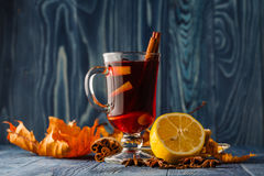 Mulled wine in glass mugs with spices and pear fruits. Autumn st Royalty Free Stock Photo