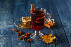 Mulled wine in glass mugs with spices and pear fruits. Autumn st Royalty Free Stock Photography