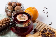 Mulled wine in glass with orange and spices stock image