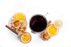 Mulled wine in a glass with spices, ginger, cinnamon and fruit on a white background Royalty Free Stock Photography