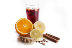 Mulled wine in a glass with spices, ginger, cinnamon and fruit on a white background Royalty Free Stock Photos