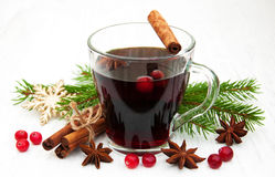 Mulled wine. Glass of mulled wine with spices on a old wooden background royalty free stock image