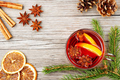 Mulled wine and spices on wooden table Royalty Free Stock Photos