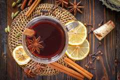 Mulled wine. In a glass on a table Stock Image