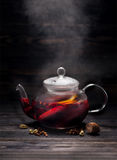 Mulled wine in the glass teapot Stock Image