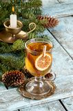 Mulled wine in glass on vintage brass coaster Stock Photos
