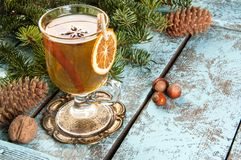 Mulled wine in glass on vintage brass coaster Stock Photo
