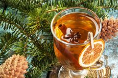 Mulled wine in glass on vintage brass coaster Royalty Free Stock Photo