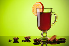 Mulled wine on green Stock Image