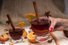 Mulled wine in hand Royalty Free Stock Image