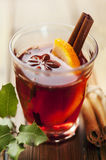Mulled wine hot toddy. Hot mulled wine, with cinnamon and orange Royalty Free Stock Photography