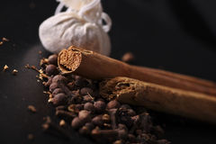 Mulled wine ingredients and calico bags. Royalty Free Stock Photo