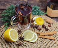 Mulled wine with a lemon, cinnamon, an anisetree,. A juniper Stock Image