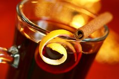 Mulled wine. With lemon peel and cinnamone stick on glass. Selective focus, shallow DOF Royalty Free Stock Photos