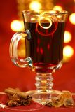 Mulled wine. With lemon peel, spices and brown sugar. Selective focus royalty free stock photo