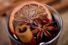 Mulled wine. Made with orange, cinnamon stick and star anise in a glass Royalty Free Stock Images