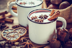 Mulled wine in mugs, dry fruits and chestnuts Royalty Free Stock Photo