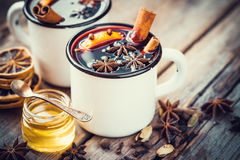 Mulled wine in mugs, dry spice and honey. Stock Photos