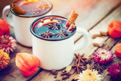 Mulled wine in mugs, spice and dry flowers. Stock Photo