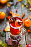 Mulled wine in mugs, spice and dry flowers and leaves. Autumn st Stock Images