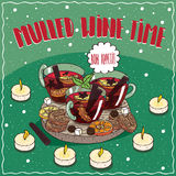 Mulled wine in mugs with sweets and cookies Stock Photos
