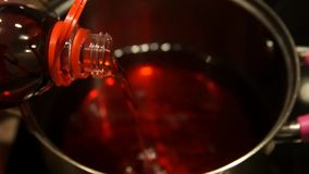 Mulled wine. Mulled wine in saucepan. Hot drink. Fruit drink. Christmas fair. Mulled wine. Chef cooking mulled wine. Cooking. Baking. Mulled wine in saucepan stock video
