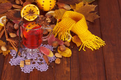 Mulled wine, nuts and sweets on background of dark wood. Stock Images