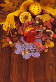 Mulled wine, nuts and sweets on background yellow maple leaves. Royalty Free Stock Photography