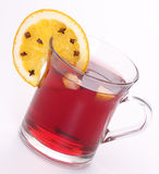 Mulled wine and orange with clove. On the background Stock Photos