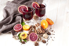 Mulled wine with orange peel and spices Royalty Free Stock Images