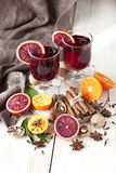 Mulled wine with orange peel and spices Stock Images