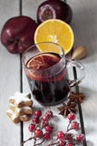 Mulled wine with orange slice cinnamon stars cinnamon stick rose hips anise on wooden background Royalty Free Stock Images