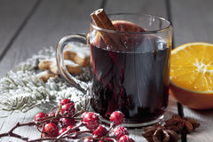 Mulled wine with orange slice cinnamon stars cinnamon stick rose hips on wooden background Royalty Free Stock Photos