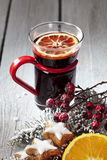 Mulled wine with orange slice cinnamon stars cinnamon sticks rose hips on wooden background Stock Photos