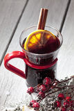 Mulled wine with orange slice cinnamon stick rose hips on wooden background Stock Photo