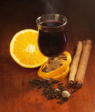 Mulled wine with orange and spices Stock Images