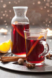 Mulled wine with orange and spices Royalty Free Stock Images
