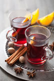 Mulled wine with orange and spices Stock Photos