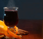 Mulled wine with orange and spices on the table Stock Photography