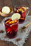 Mulled wine with orange on wooden background royalty free stock photography