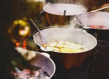 Mulled wine with oranges in large vats on Christmas market. New year and Christmas celebration concept, traditional drink royalty free stock photography