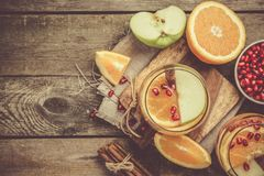 Mulled wine with oranges, pomegranate Stock Image