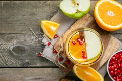 Mulled wine with oranges, pomegranate Stock Photo