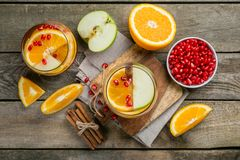 Mulled wine with oranges, pomegranate Royalty Free Stock Images
