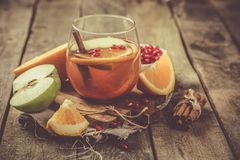 Mulled wine with oranges, pomegranate Royalty Free Stock Photos