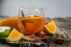 Mulled wine with oranges, pomegranate Stock Images