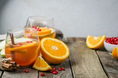Mulled wine with oranges, pomegranate Stock Photos