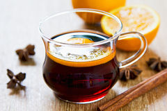 Mulled wine. With pieces of orange and spices royalty free stock images